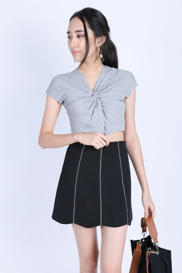 RAW EDGES TWISTED CROP TOP IN LIGHT GREY