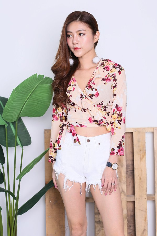 RAINE FLORAL WRAP TOP IN NUDE PINK